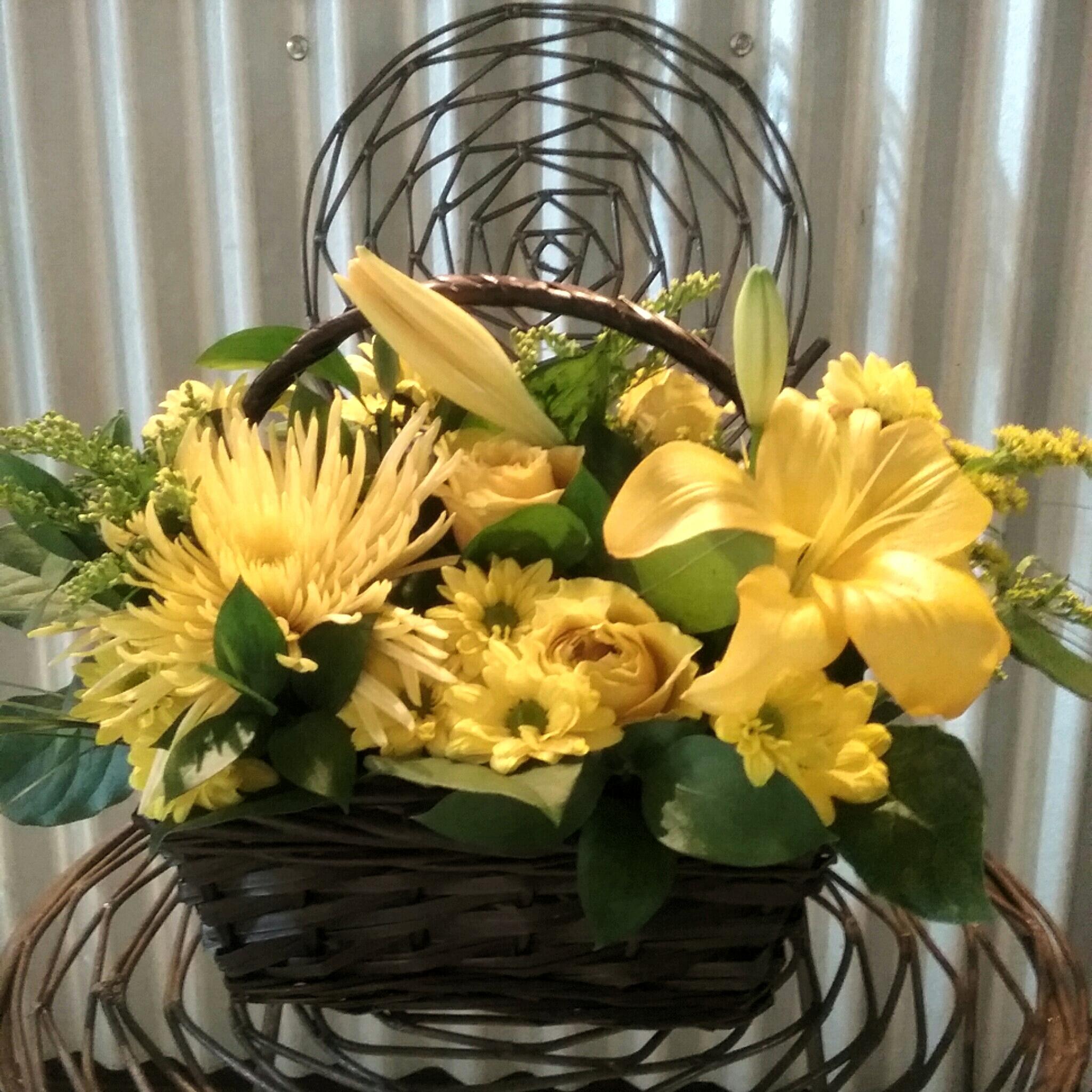 Yellow flowers in a wicker basket