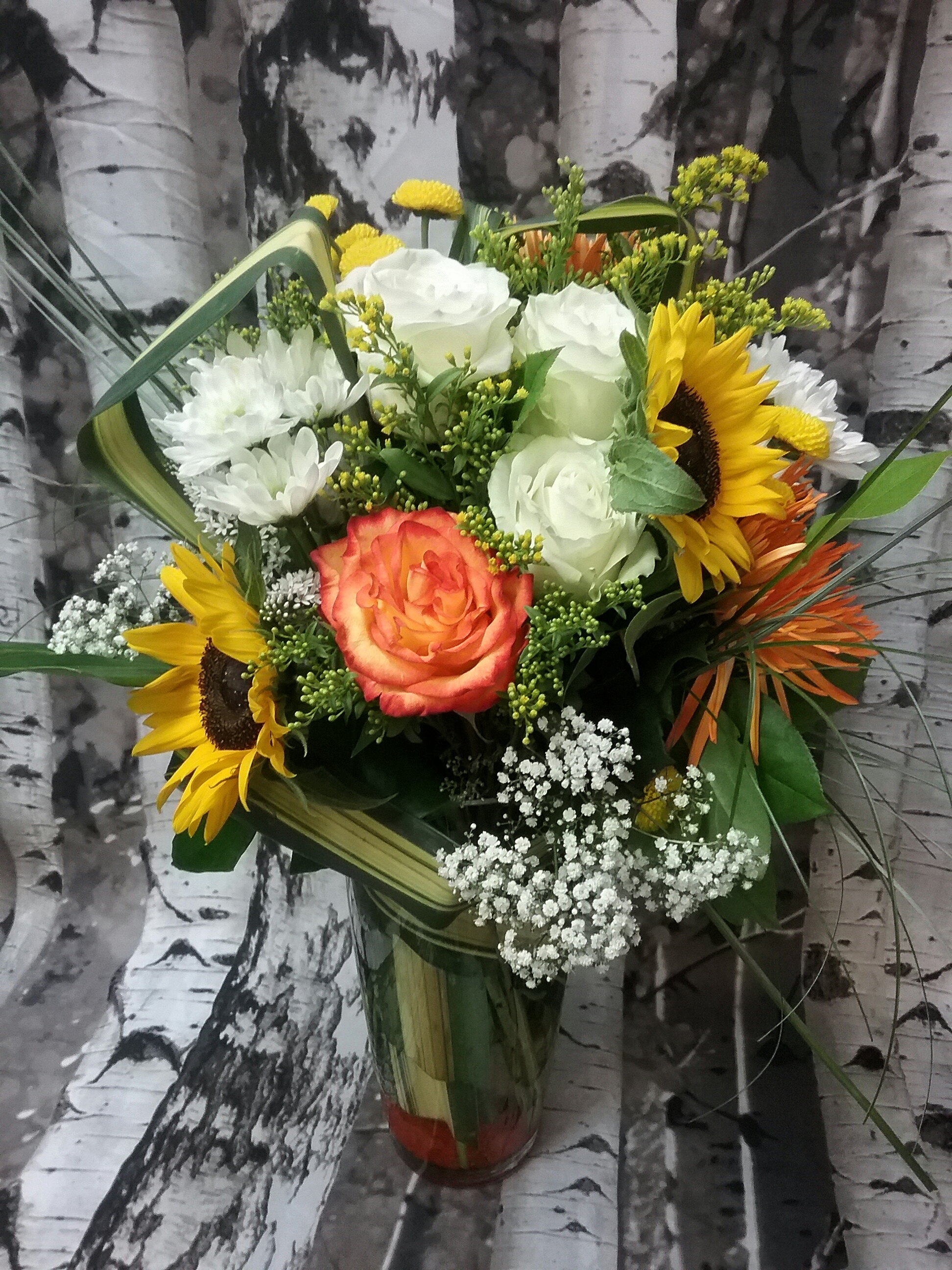 sunflowers, roses, chrysanthemums,solidago, gypsophile