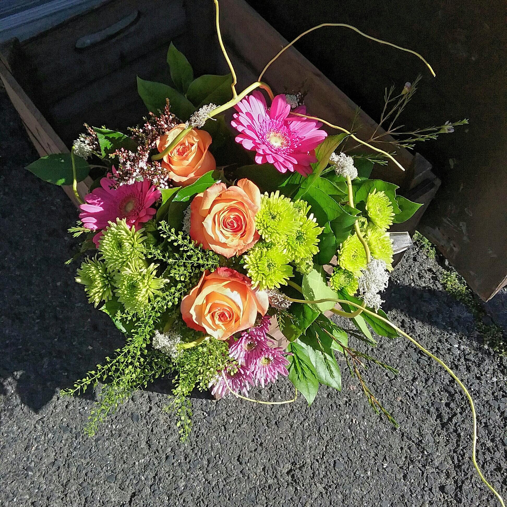 gerbera, roses ,thlaspi ( grasses) and chrysanthemums